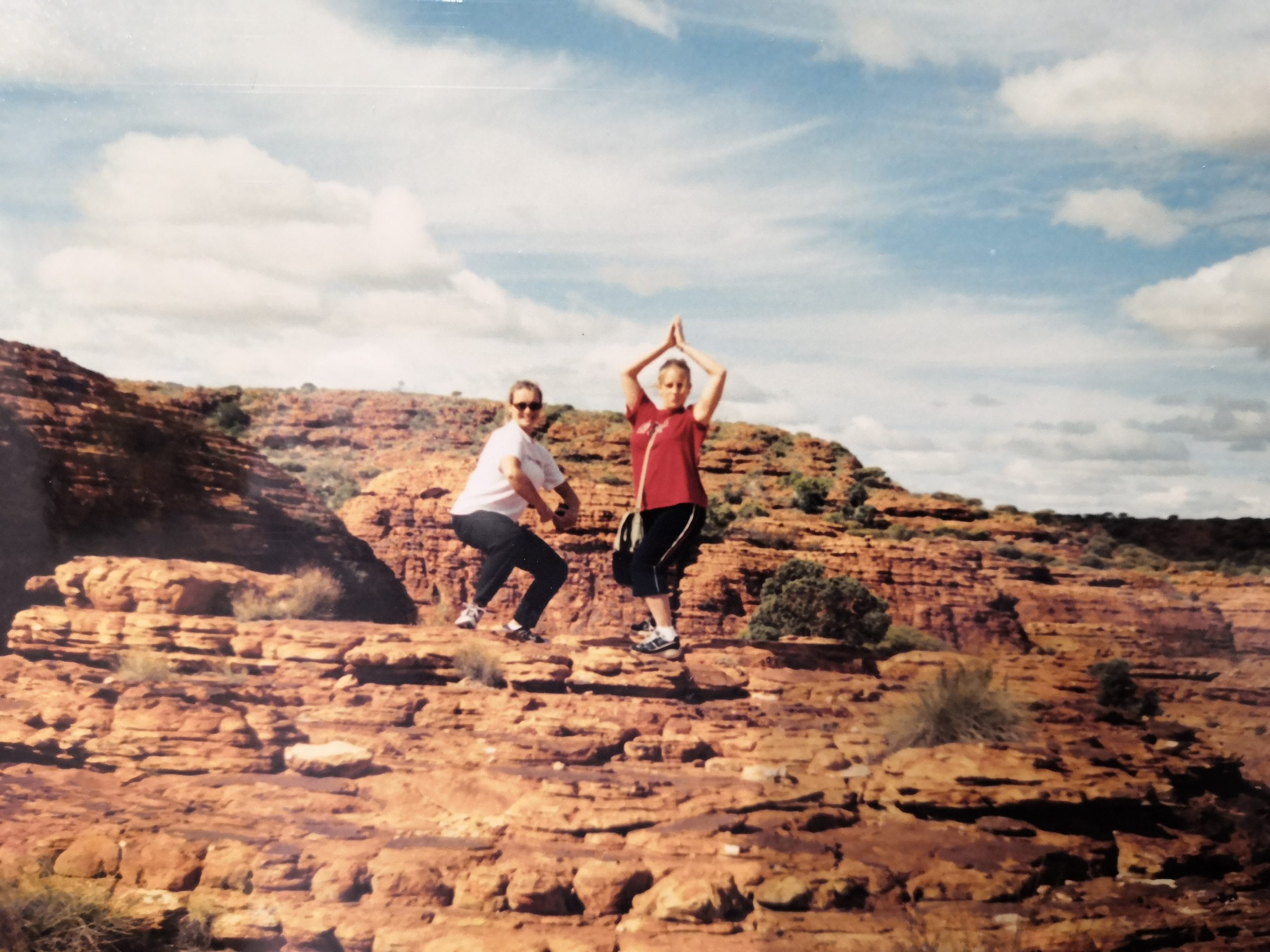 Silly poses on top of Kings Canyon in the Australian Outback
