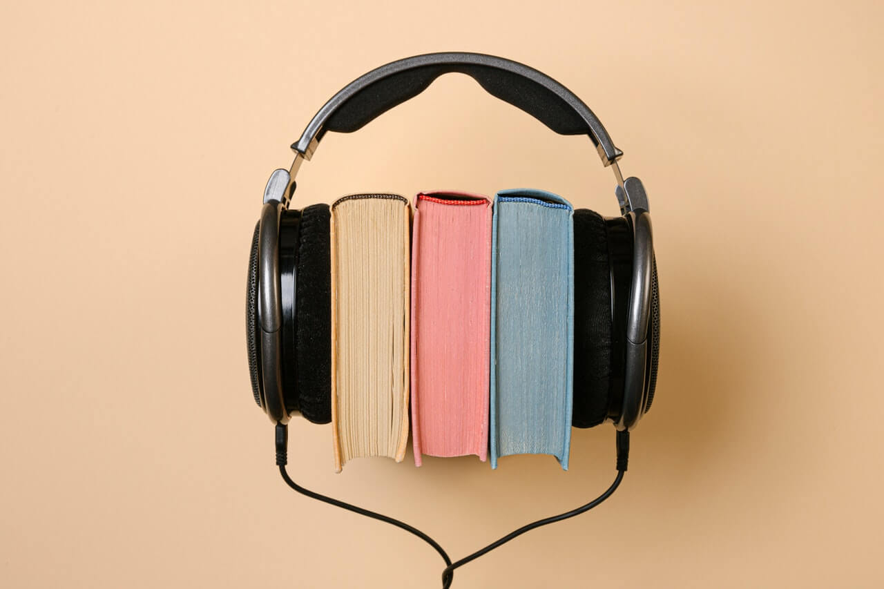 books with headphones representing audio books