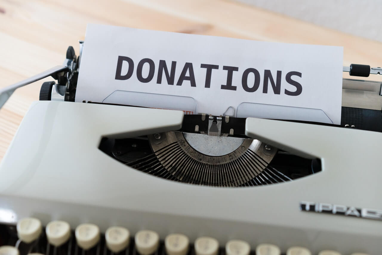 Typewriter with the words DONATIONS typed out
