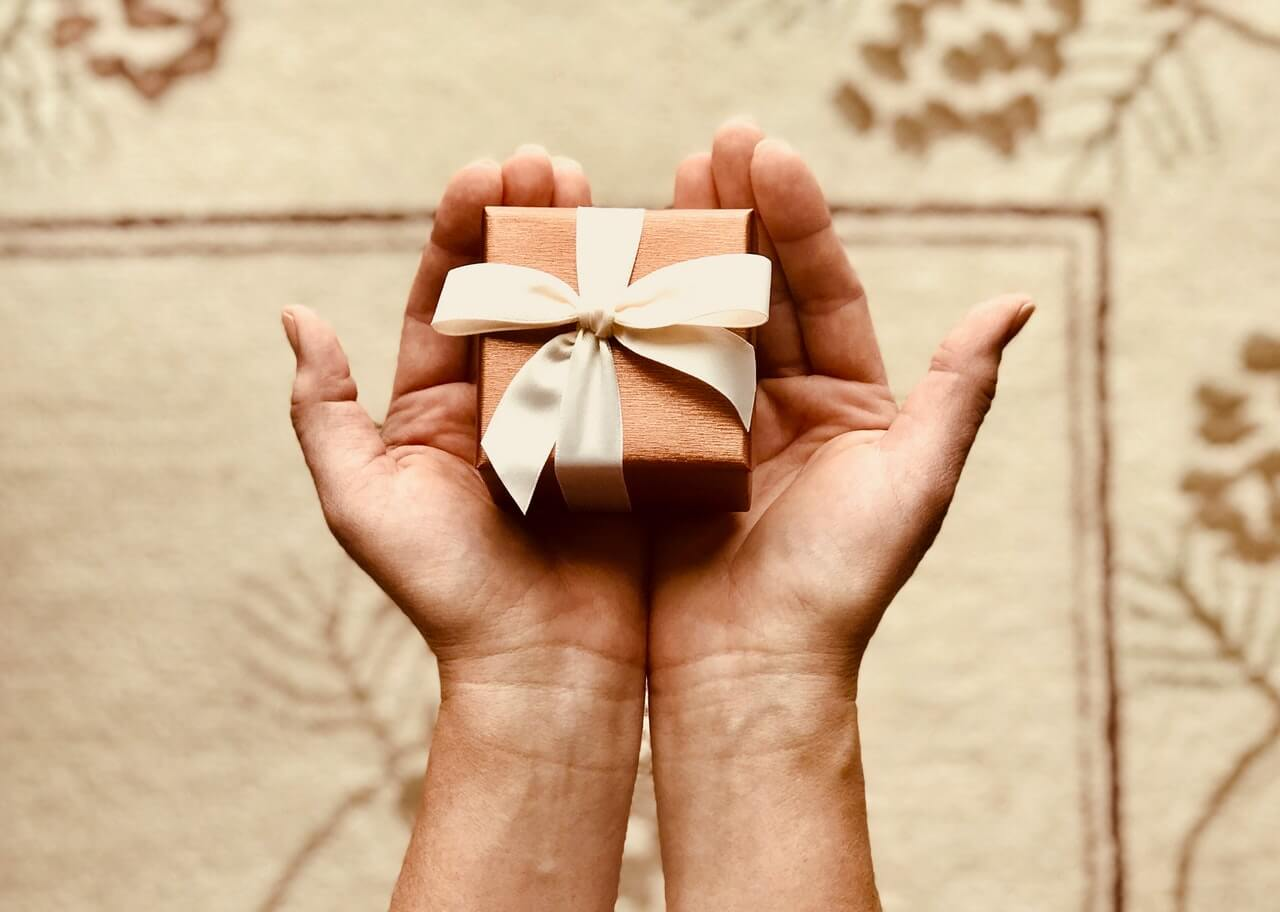 Tiny space saving gift box held in hands