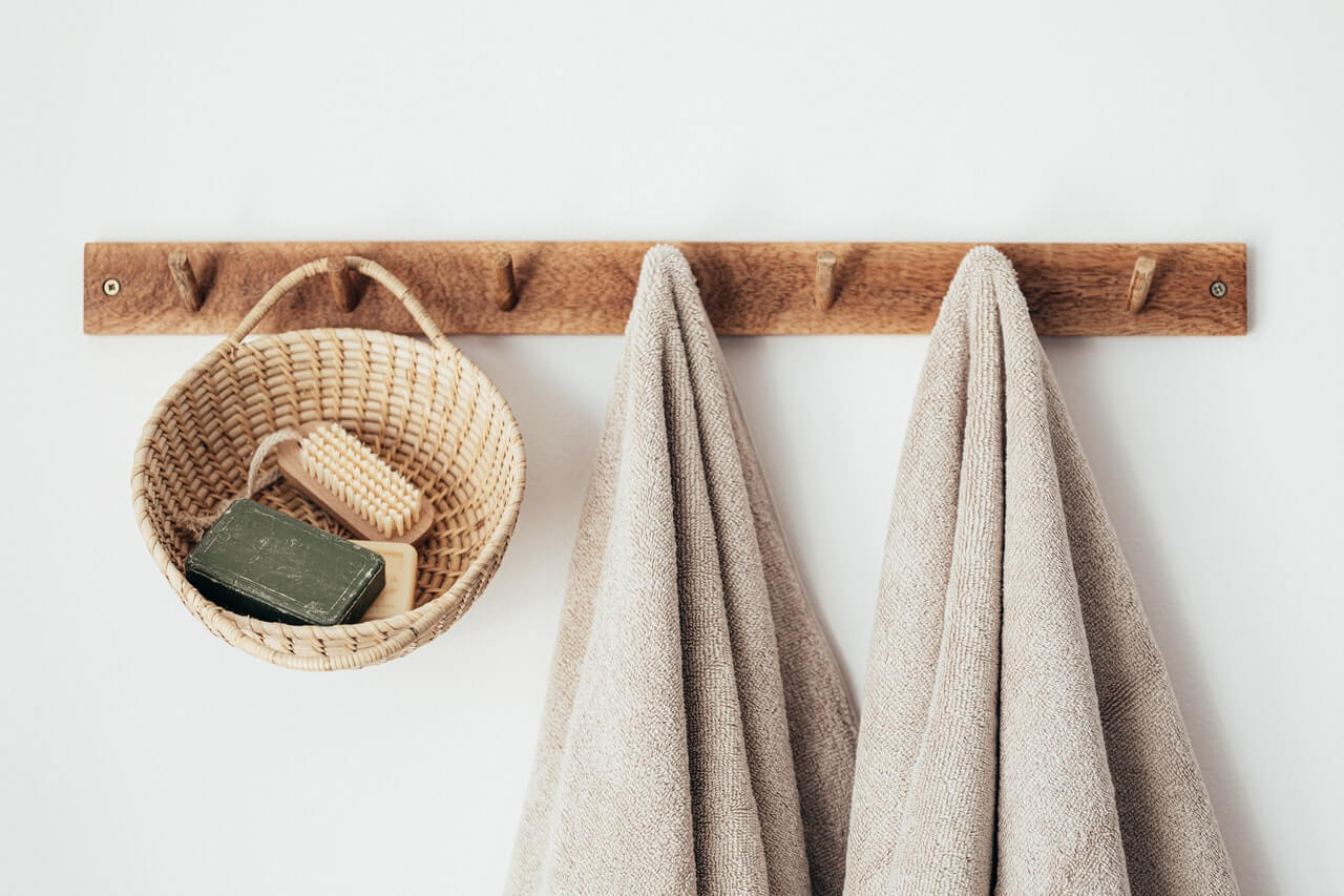 Wall hooks and basket that organise clutter